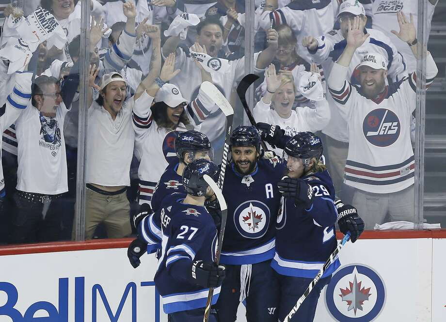 Winnipeg Jets' Nikolaj Ehlers (27), Mark Scheifele (55), Dustin Byfuglien (33) and Patrik Laine (29) celebrate Byfuglien's goal against the Vegas Golden Knights during the first period of Game 1 of the NHL hockey playoffs Western Conference final, Saturday, May 12, 2108, in Winnipeg, Manitoba. (John Woods/The Canadian Press via AP) Photo: JOHN WOODS, Associated Press