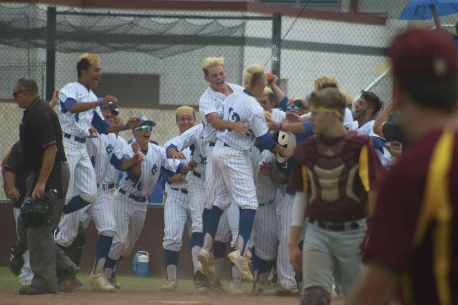 Pandemonium erupts around home plate Saturday afternoon as Brady Miller is mobbed, following his walk-off home run in the eighth inning that allowed Clear Springs to come all the way back from a 9-0 deficit, winning 11-10. Photo: Robert Avery