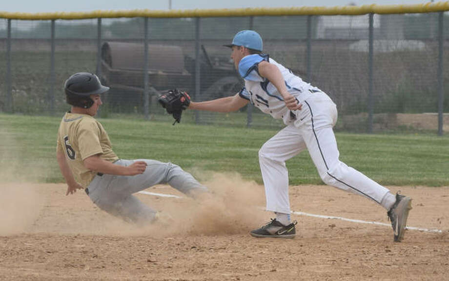 Triopia's Garrett Snow (11) tags out a Camp Point Central runner after a rundown Saturday at Concord.