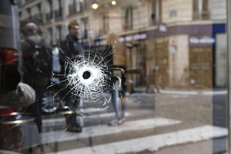 A bullet penetrated a window at the scene in Paris where officers fatally shot a stabbing suspect. Photo: Eric Feferberg / AFP / Getty Images