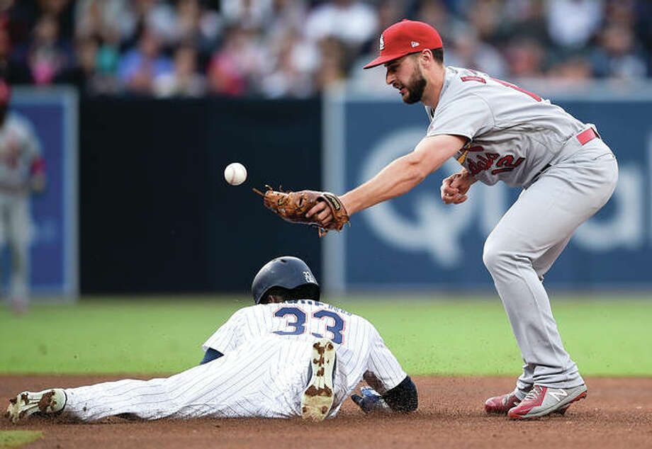 Cardinals shortstop Paul DeJong (right) is unable to catch the throw as the Padres' Franchy Cordero steals second base during the fourth inning Saturday night in in San Diego. Photo:       Associated Press
