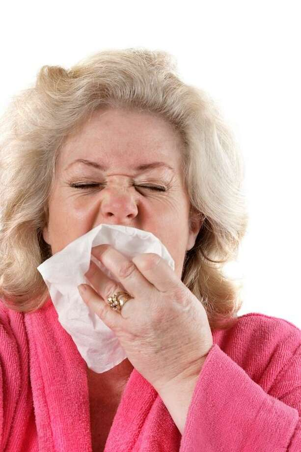 """Though people continue to get sick and die from the flu in Connecticut, the state Department of Public Health reports that flu activity in the state has been downgraded, from """"widespread"""" to """"regional."""" Photo: Jo Ann Snover / Fotolia / @ 2007 Jo Ann Snover"""