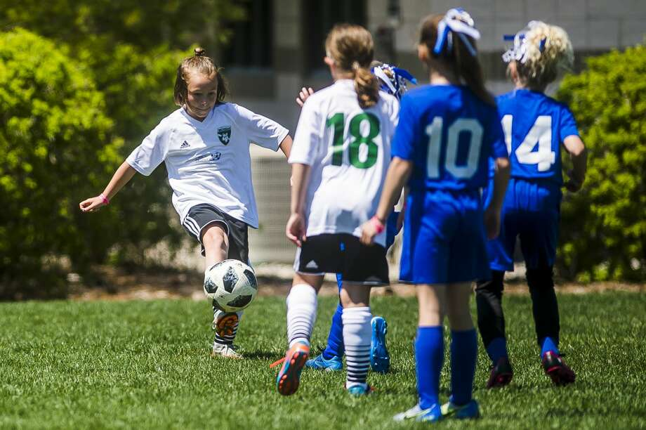 Emmie Ostyn of Midland Fusion 09 White sends the ball down the field in a game against BASA 2009 in the U9 girls division during the 36th annual Midland Invitational Tournament on Sunday, May 13, 2018 at the Midland Soccer Complex. (Katy Kildee/kkildee@mdn.net) Photo: (Katy Kildee/kkildee@mdn.net)