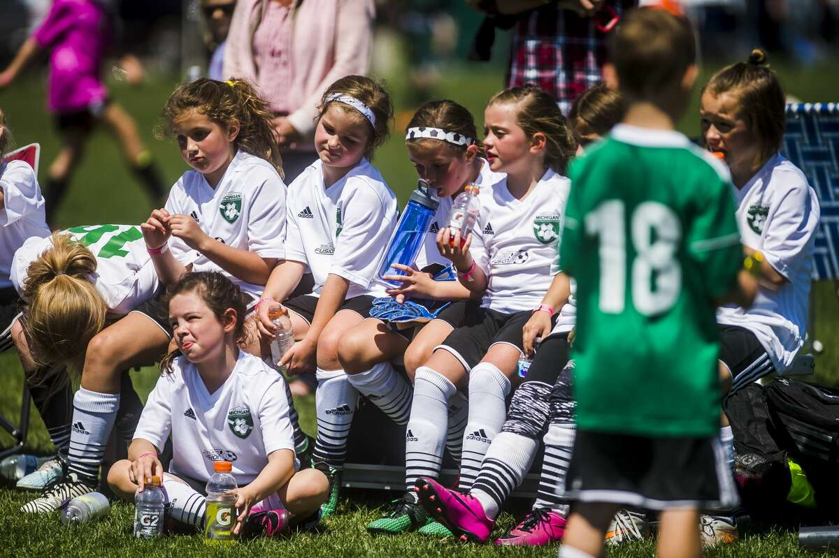 Midland Fusion 09 White gathers on the bench after their game against BASA 2009 in the U9 girls division during the 36th annual Midland Invitational Tournament on Sunday, May 13, 2018 at the Midland Soccer Complex. (Katy Kildee/kkildee@mdn.net)