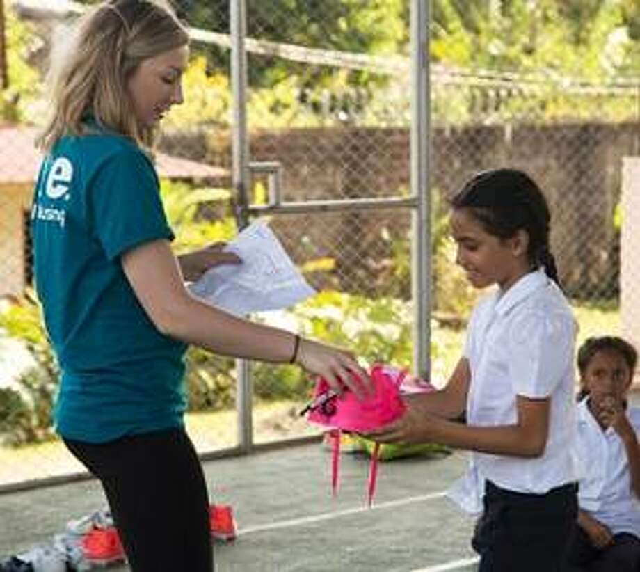 An SIUE Nursing student provides shoes to a Costa Rican girl. Photo:       For The Telegraph