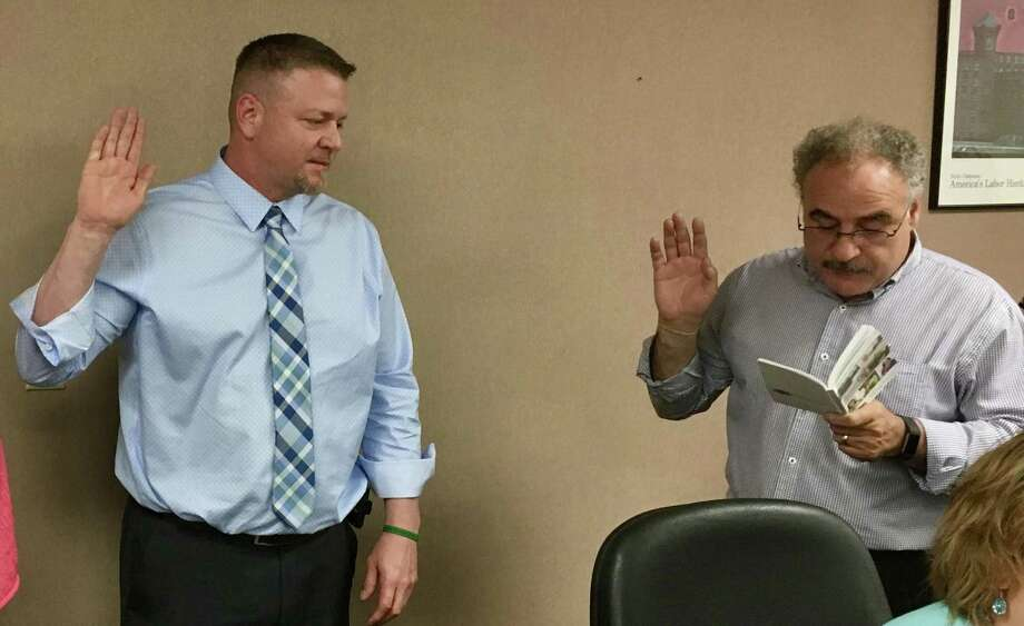 Outgoing Council 4 Executive Director Sal Luciano, right, swears in his successor, Jody Barr, after Barr was elected Friday night. Photo: Contributed Photo / Council 4, AFSCME