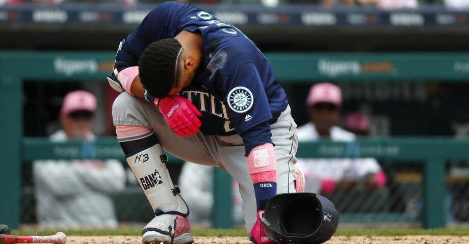 Seattle Mariners' Robinson Cano (22) reacts after being hit on the hand by a Detroit Tigers relief pitcher Blaine Hardy pitch in the third inning of a baseball game in Detroit, Sunday, May 13, 2018. (AP Photo/Paul Sancya) Photo: Paul Sancya/Associated Press
