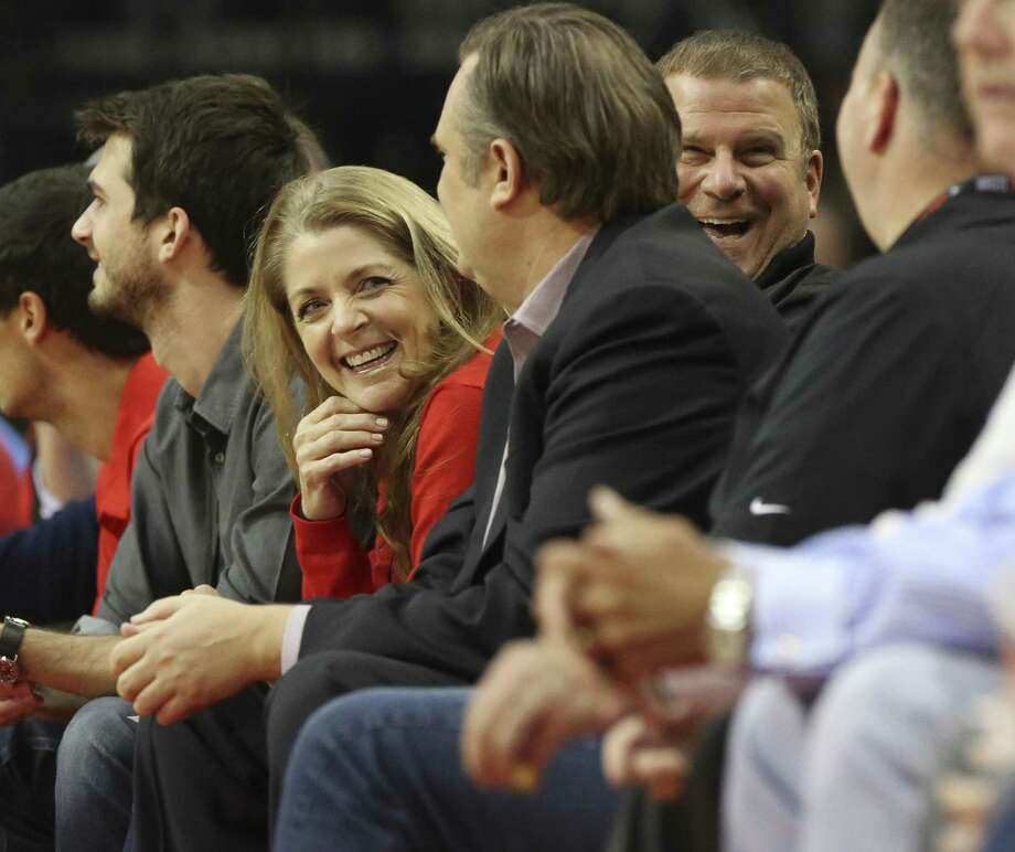 Rocekts owner Tilman Fertitta, wife Paige, and son Michale join the Rockets general manager Daryl Morey to watch the game against the Memphis Grizzlies at Toyota Center Monday, Oct. 23, 2017, in Houston. ( Yi-Chin Lee / Houston Chronicle ) Photo: Yi-Chin Lee, Houston Chronicle / Houston Chronicle / © 2017  Houston Chronicle