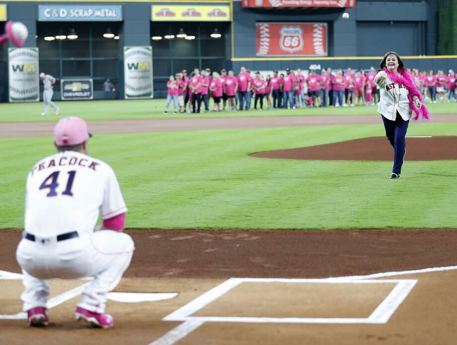 Fran Linton throws out the first pitch to Houston Astros relief pitcher Brad Peacock (41) before the start of an MLB game at Minute Maid Park, Sunday, May 13, 2018, in Houston. Linton, of Humble, is the team's Honorary Bat Girl on Mother's Day.( Karen Warren  / Houston Chronicle ) Photo: Karen Warren/Houston Chronicle