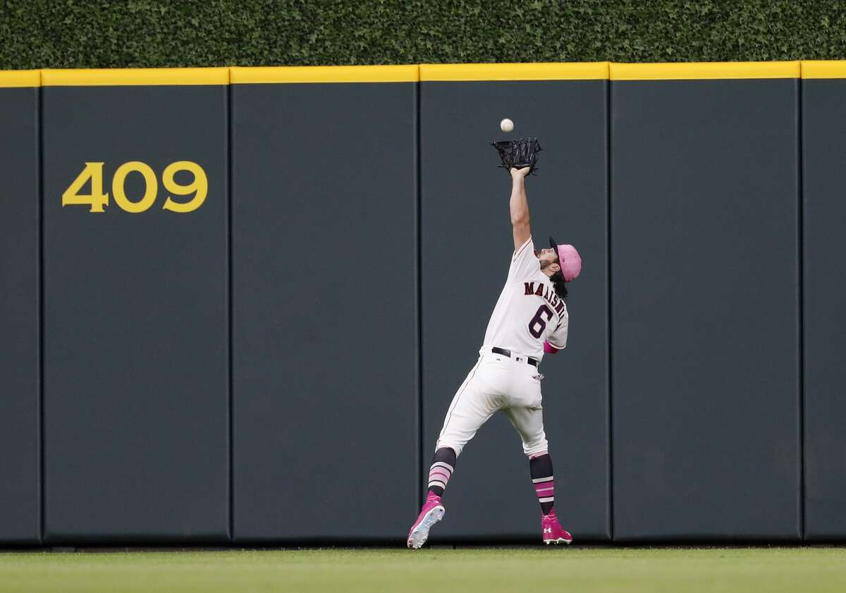 Houston Astros center fielder Jake Marisnick (6) reaches up to catch Texas Rangers Isiah Kiner-Falefa's fly out during the second inning of an MLB game at Minute Maid Park, Sunday, May 13, 2018, in Houston. ( Karen Warren / Houston Chronicle )