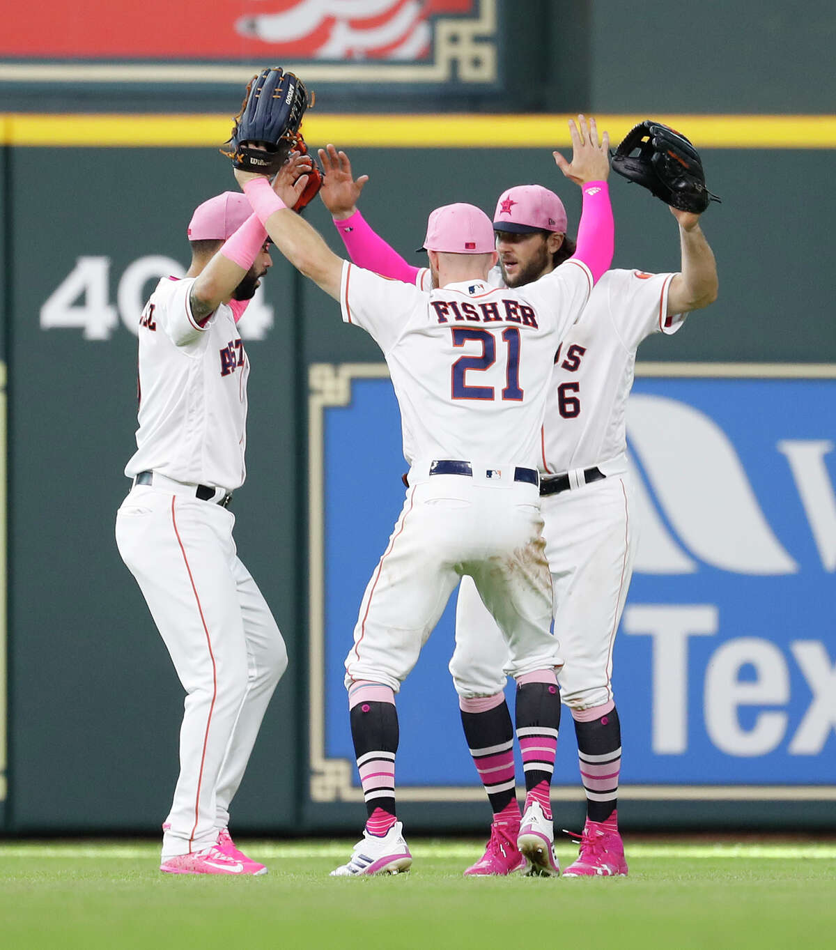 Houston Astros Derek Fisher (21), Jake Marisnick (6), and Marwin Gonzalez (9)celebrate after relief pitcher Brad Peacock closed out the ninth inning of an MLB game at Minute Maid Park, Sunday, May 13, 2018, in Houston. ( Karen Warren / Houston Chronicle )