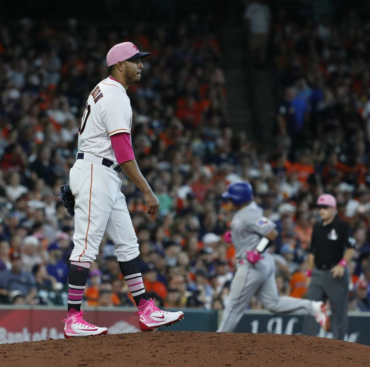 Houston Astros relief pitcher Hector Rondon (30) reacts after giving up a home run to Texas Rangers Carlos Perez during the eighth inning of an MLB game at Minute Maid Park, Sunday, May 13, 2018, in Houston. ( Karen Warren / Houston Chronicle )