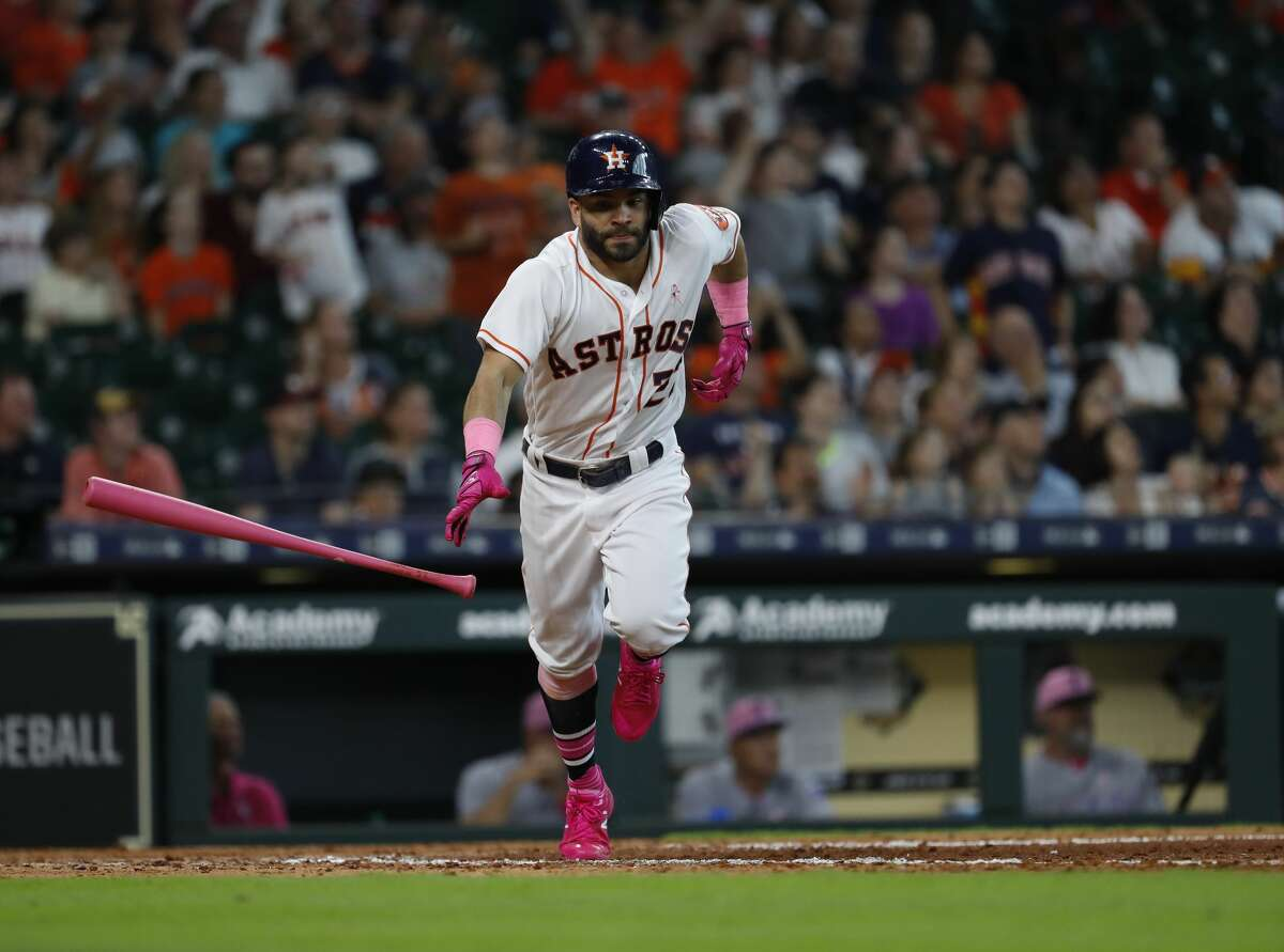 Houston Astros second baseman Jose Altuve (27) throws his bat after flying out during the eighth inning of an MLB game at Minute Maid Park, Sunday, May 13, 2018, in Houston. ( Karen Warren / Houston Chronicle )