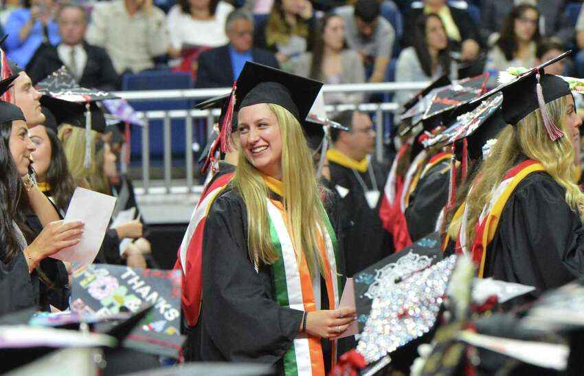 Caitlyn Quigley is ready to go up and get her diploma during the Sacred Heart University Graduation Ceremony on Sunday May 13, 2018 at Webster Bank Arena in Bridgeport Conn.