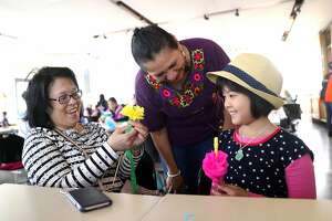 Irma Ortiz (center) instructs Wendy Pan of San Jose and her daughter, Hayden, 10, on Mother's Day at Exploratorium in San Francisco, CA on Sunday, May 13, 2018.