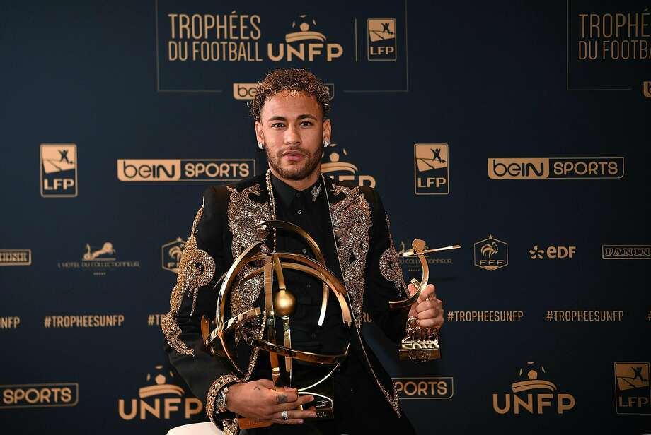 TOPSHOT - Paris Saint-Germain's Brazilian forward Neymar poses with his trophy after receiving the Best Ligue 1 Player award during a TV show on May 13, 2018 in Paris, as part of the 27th edition of the UNFP (French National Professional Football players Union) trophy ceremony. / AFP PHOTO / FRANCK FIFEFRANCK FIFE/AFP/Getty Images Photo: FRANCK FIFE;Franck Fife / AFP / Getty Images