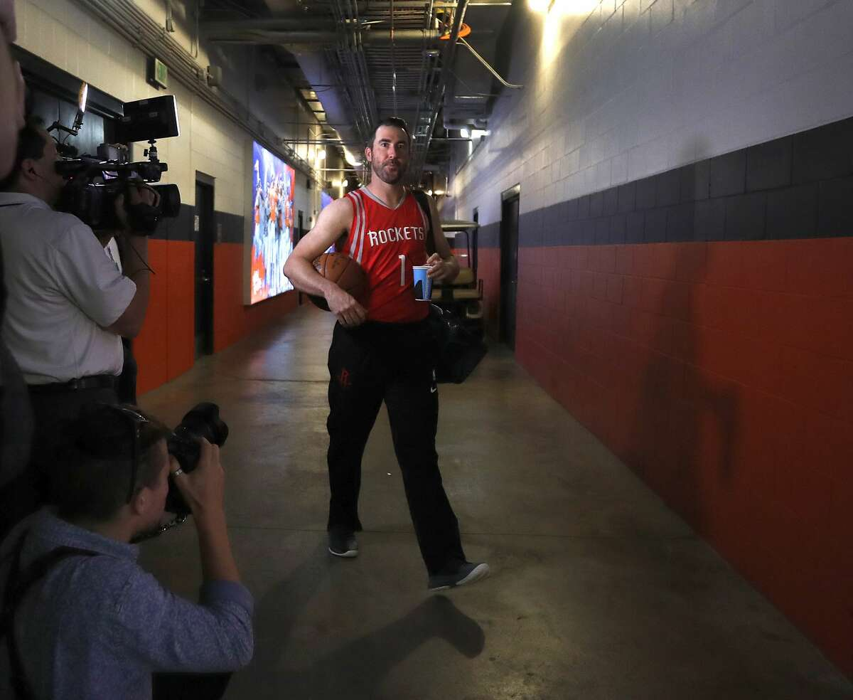 """PHOTOS: A look at the Astros wearing Rockets jerseys for their road trip Houston Astros starting pitcher Justin Verlander wears a """"Run As One"""" Rockets jersey after an MLB game at Minute Maid Park, Sunday, May 13, 2018, in Houston. The entire team wore Rockets gear in support of the team as they head to the Western Conference finals Monday. ( Karen Warren / Houston Chronicle ) Browse through the photos above for a look at the Astros wearing Rockets gear as they head out on their road trip."""
