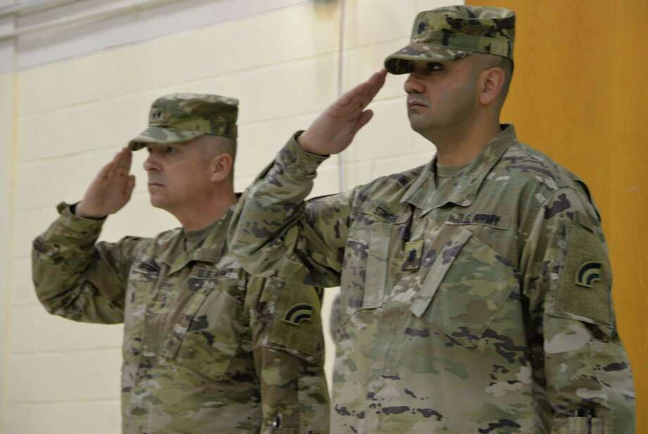 New York Army National Guard Lt. Col. Gupreet Singh joins Major Gen. Steven Ferrari (left) the commander of the 42nd Infantry Division in saluting the colors during change of command and promotion ceremonies at Camp Smith Training Site in Cortlandt Manor, N.Y. on May 6, 2018. Singh assumed command of the 42nd Infantry Division Headquarters Battalion and was also promoted to Lieutenant Colonel by Major General Steven Ferrari during the ceremony.(New York Army National Guard photo by Capt. Jean Marie Kratzer) Photo: Cap. Jean Marie Kratzer