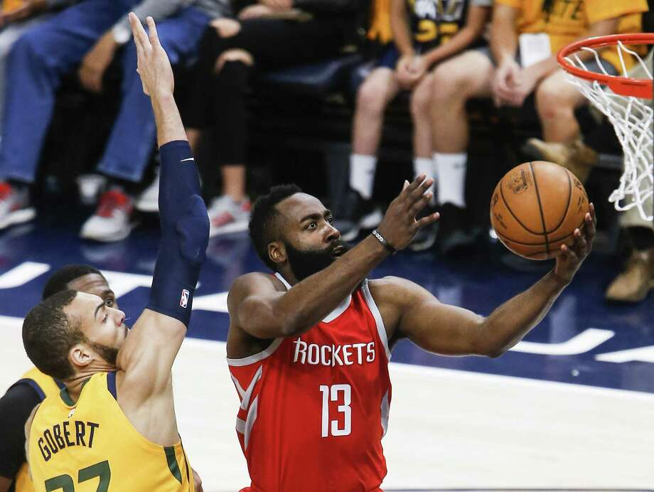 Houston Rockets guard James Harden (13) takes the ball to the basket past Utah Jazz center Rudy Gobert (27) during the first half of Game 4 of the NBA second-round playoff series at Vivint Smart Home Arena Sunday, May 6, 2018 in Salt Lake City. (Michael Ciaglo / Houston Chronicle) Photo: Michael Ciaglo, Houston Chronicle / Houston Chronicle / Michael Ciaglo