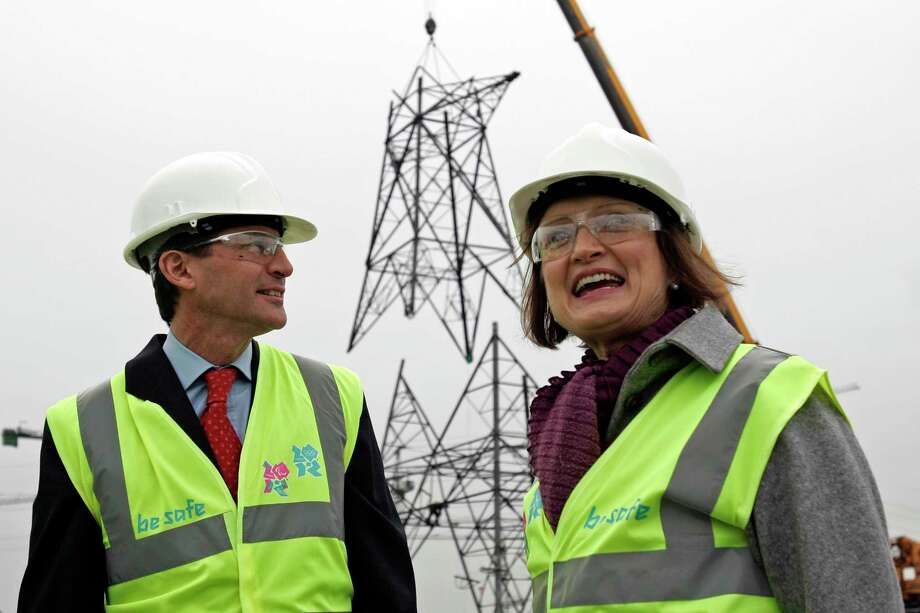 "FILE - In this Thursday, Nov. 13, 2008 file photo, Britain Olympics Minister Tessa Jowell, right, and Sebastian Coe, Chairman of the London 2012 Organising Committee, pose in front of a powerline pylon at the 2012 Olympic Park site in London. Tessa Jowell, the former U.K. culture secretary who played a key role in securing the 2012 London Olympics, has died her family has said on Sunday, May 13, 2018. Jowell, was 70, was diagnosed with a brain tumor last year. Among those offering condolences were former Prime Minister Tony Blair who praised Jowell's ""passion, determination and simple human decency."" (AP Photo/Sang Tan, file) Photo: SANG TAN / 2008 AP"