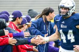 November 28, 2015: Rice Owls defensive end Brian Womac (44) shakes hands with the Pearland Little League World Series team, recognized during the Charlotte 49ers at Rice Owls game at Rice Stadium, Houston, Texas. (Photo by Ken Murray/ICON Sportswire) (Photo by Ken Murray/Icon Sportswire/Corbis via Getty Images)