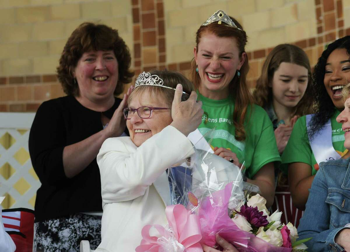 Mother of the Year, June MacClelland, from Wilton, adjusts her crown after having it placed on her head at the 20th Annual Mother of The Year Award Ceremony at the annual Tulip Festival on Sunday, May 13, 2018, in Albany, N.Y. The Mother of the Year Award is Presented by St. Peter's Health Partners, Times Union, and B95.5. (Paul Buckowski/Times Union)