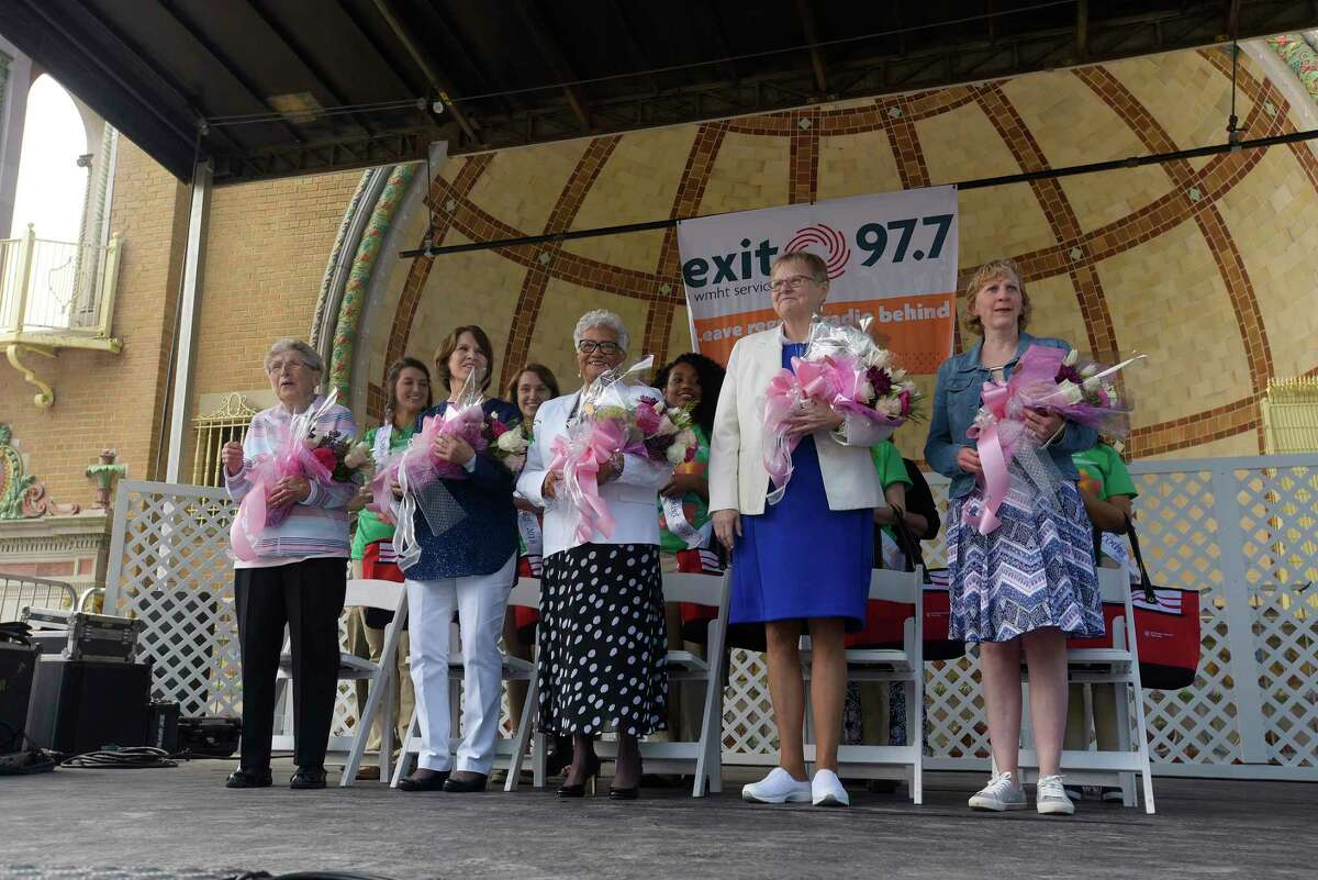 Finalists for Mother of the Year, from left to right, Joan Duffey from Watervliet, Joanne Joseph from Ballston Spa, Harriet Lovelady from Albany, June MacClelland from Wilton and Kathleen Shaw from Cohoes stand on stage at the start of the 20th Annual Mother of The Year Award Ceremony at the annual Tulip Festival on Sunday, May 13, 2018, in Albany, N.Y. The Mother of the Year Award is Presented by St. Peter's Health Partners, Times Union, and B95.5. (Paul Buckowski/Times Union)
