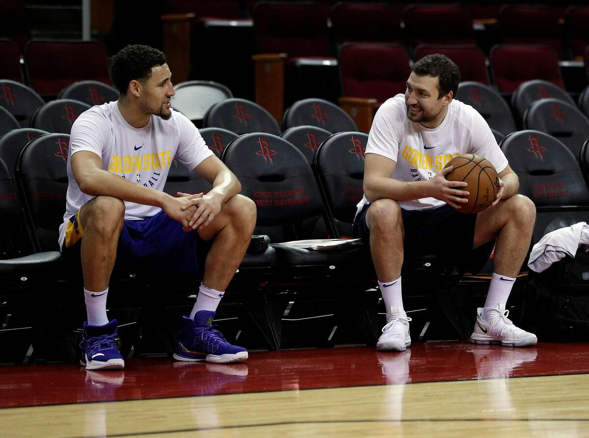 Klay Thompson (11) talks with Chris DeMarco, assistant coach for player development as the Golden State Warriors practiced on Sunday ahead of the Monday's Western Conference Finals game against Houston Rockets at Toyota Center in Houston, Tex., on Sunday, May 13, 2018.