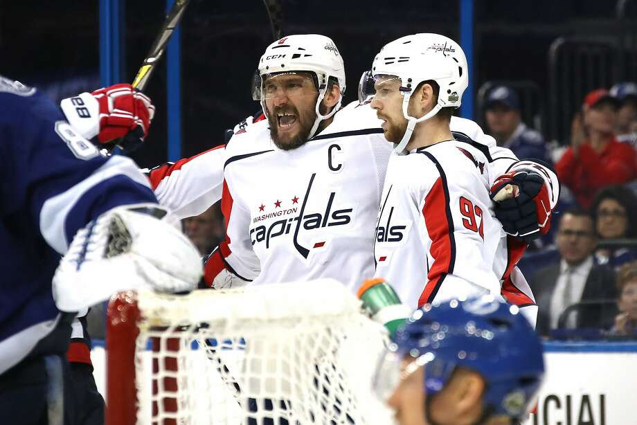 Alex Ovechkin of the Washington Capitals celebrates with teammate Evgeny Kuznetsov after his goal in the third period in Game 2 against Tampa Bay. Photo: Bruce Bennett / Getty Images