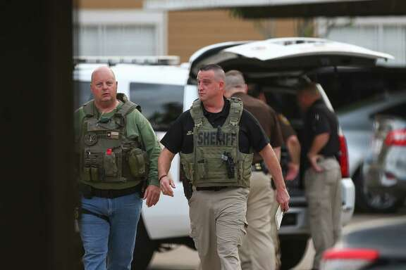 Fort Bend County Sheriff's Office deputies investigate the scene where a man is barricaded at Willow Lake Apartments, after allegedly killing his wife Monday, May 14, 2018, in Katy, Texas. FBCSO received a call reporting that a man had killed his wife and would kill himself.