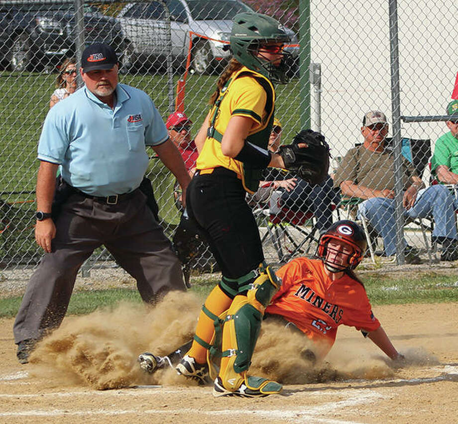 Gillespie's Ally Clay (right) kicks up dust as she slides in safely with a run while Southwestern catcher Megan Bailey waits on a throw that does not come in a Miners' SCC victory May 1 in Piasa. Gillespie and Southwestern, which both shared the SCC title with Hillsboro, open Class 2A regional play this week on fields where the home team is the top seed. Gillespie is at the Hillsboro Regional, while Southwestern is at the Marquette Regional. Photo:       Greg Shashack / The Telegraph