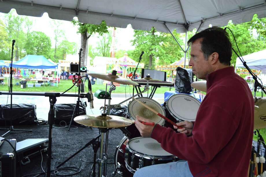 Adam Weiss, part of the New Canaan-based band Not My Problem, keeps the beat going at the 69th annual May Fair at St. Mark's Episcopal Church, Saturday, May 12, 2018, in New Canaan, Conn. Photo: Jarret Liotta / For Hearst Connecticut Media / New Canaan News Freelance