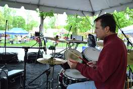 Adam Weiss, part of the New Canaan-based band Not My Problem, keeps the beat going at the 69th annual May Fair at St. Mark's Episcopal Church, Saturday, May 12, 2018, in New Canaan, Conn.