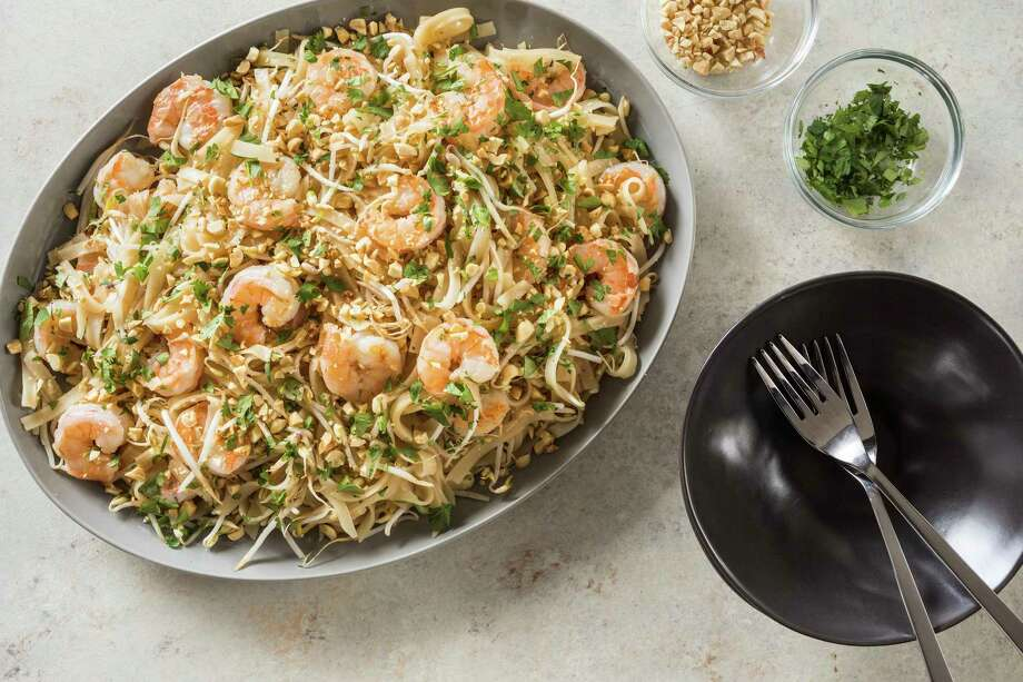 "This undated photo provided by America's Test Kitchen in May 2018 shows one-pan shrimp pad thai in Brookline, Mass. This recipe appears in the cookbook ""Dinner Illustrated."" (Daniel J. van Ackere/America's Test Kitchen via AP) Photo: Daniel J. Van Ackere, AP / © 2017 America's Test Kitchen, LLC. All Rights Reserved."