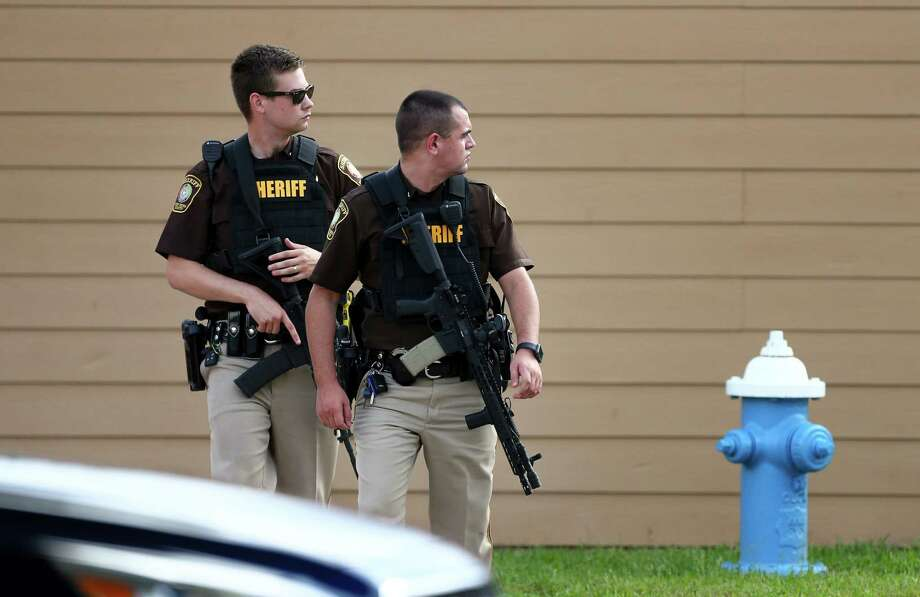 Fort Bend County Sheriff's Office deputies investigate the scene where a man is barricaded at Willow Lake Apartments, after allegedly killing his wife Monday, May 14, 2018, in Katy, Texas. FBCSO received a call reporting that a man had killed his wife and would kill himself. Photo: Godofredo A. Vasquez, Houston Chronicle