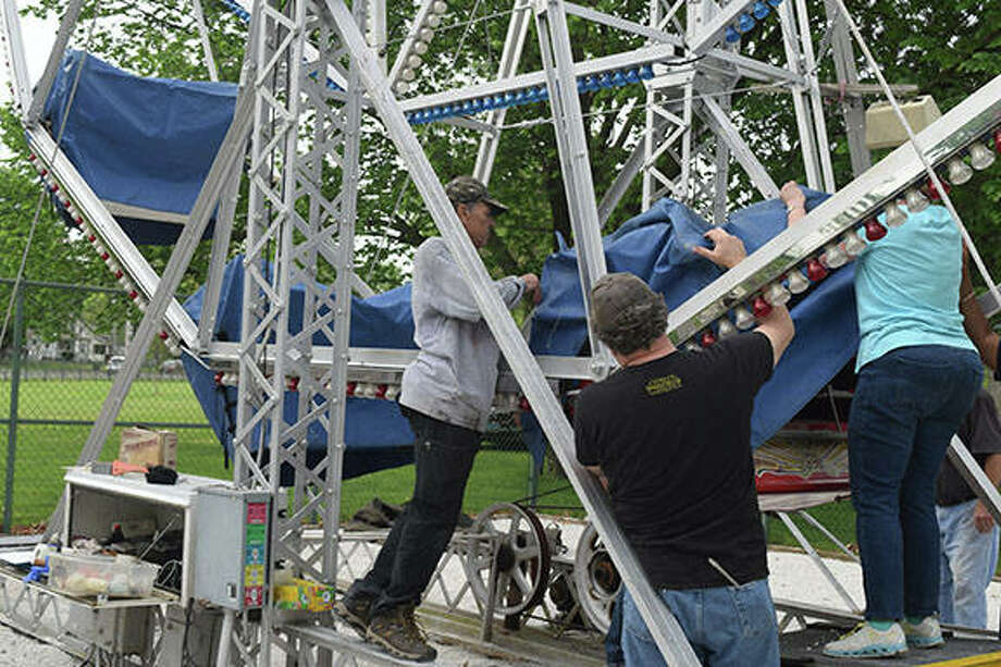 Jacksonville Rotary members prepare the Ferris wheel in Community Park for a new season. Club members operate the Ferris wheel from 4 to 6 p.m. Sundays during the summer starting Memorial Day weekend. W.E. Sullivan's Eli Bridge Co. debuted the first Big Eli Ferris wheel in Jacksonville's Central Park in 1900. The company has been building its brand of Ferris wheels in town since 1919. Photo:       Samantha McDaniel-Ogletree | Journal-Courier