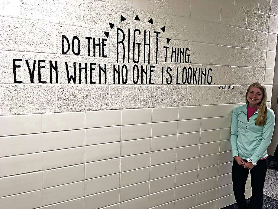 "Class Vice President Heidi Ewald stands next to one of five anti-bullying messages recently created in Caseville Public Schools. The message reads, ""Do the right thing, even when no one is looking."" (Above left) Class Secretary Kylie Bilkie stands next to a message that reads, ""Some kids are smarter than you. Some kids have cooler clothes than you. Some kids are better at sports than you. It doesn't matter. You have your thing too. Be the kid who can get along. Be the kid who is generous. Be the kid who is happy for others. Be the kids who does the right thing. Be the nice kid."" (Below left) Class Treasurer Rebecca Simpson displays one of five newly anti-bullying messages recently created in Caseville Public Schools. The message reads, ""If you start here, you can go anywhere."" (Below right) Class President Olivia Grates poses with one of five anti-bullying messages recently created in Caseville Public Schools. The message reads, ""Knowing what is right doesn't mean much unless you do what is right."" Photo: Submitted Photo"