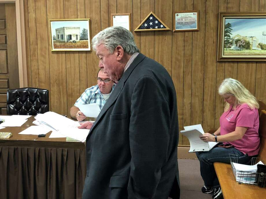 Randy Blanks of Waxman and Associates discusses the bids for the Coldspring and Shepherd senior centers during the May 9 San Jacinto County Commissioners Court. Photo: Jacob McAdams / HCN