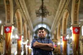 In this April 16, 2018 photo, Jaime Concha poses for a photo inside La Merced Catholic Church, in Santiago, Chile. Concha said he was 12 years old when he was raped by Abel Perez, a Marist brother, during a boy scout field trip in the 1970s. He said Perez, a trip chaperone, took him to a tent after he fell ill, and gave him herbal tea mixed with alcohol. (AP Photo/Esteban Felix)
