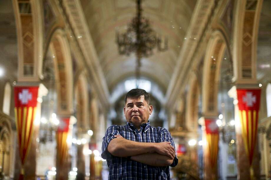 Jaime Concha, standing inside La Merced Catholic Church last month in Santiago, says he was 12 years old when he was abused by Abel Perez, a Marist brother, during a boy scout field trip. Photo: Esteban Felix / Associated Press