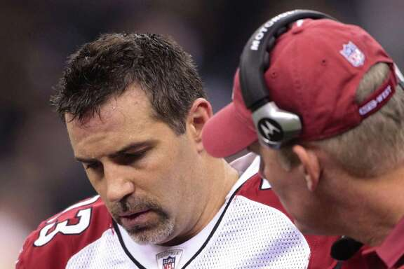 FILE - In this Jan. 16, 2010 file photo, Arizona Cardinals quarterback Kurt Warner (13) walks off the field after being injured during the second quarter of an NFL football divisional playoff game against the New Orleans Saints in New Orleans. The NFL began its investigation in early 2010 after receiving allegations that quarterbacks Kurt Warner of Arizona and Brett Favre of Minnesota had been targeted.  (AP Photo/Dave Martin, File)
