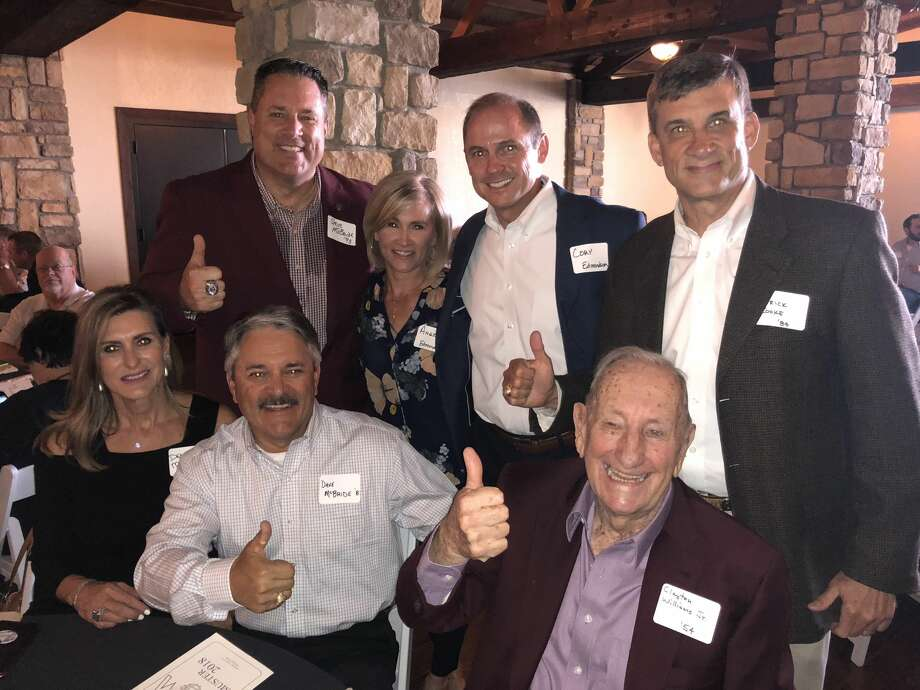 Aggie Muster: Steve McBride, back row from left, Angie Edmondson, Cory Edmondson and Patrick Cooke; and Deborah McBride, front row from left, David McBride and Clayton Williams Jr. Photo: Courtesy Photo