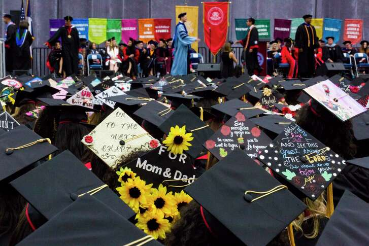 University of Houston undergraduate students wear decorated mortarboards during the commencement ceremony, Thursday, May 10, 2018, in Houston.