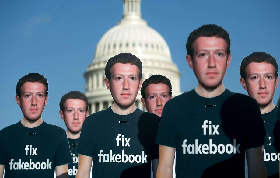 "One hundred cutouts of Facebook founder and CEO Mark Zuckerberg stand outside the Capitol in Washington, DC. Zuckerberg said he was ""happy"" to testify before Congress. Photo: SAUL LOEB;Saul Loeb / AFP / Getty Images"