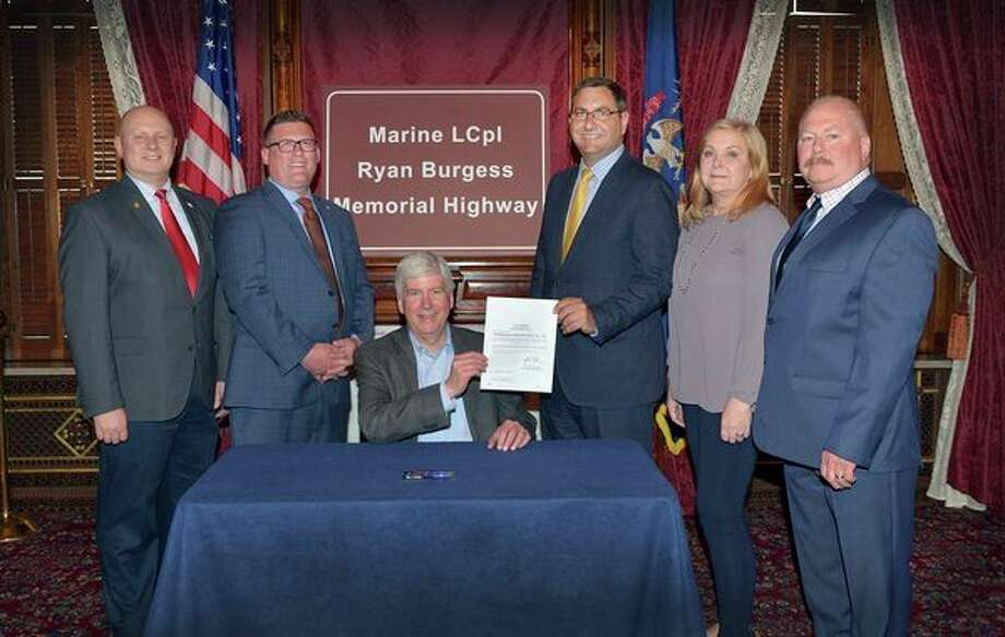 From left, state Rep. Gary Glenn, Rep. Roger Hauck, Gov. Rick Snyder, Sen. Jim Stamas, Kim Burgess and Jon Burgess attend a May 8 bill signing ceremony for Stamas' legislation to permanently honor U.S. Marine Lance Cpl. Ryan Burgess. (Photo provided)