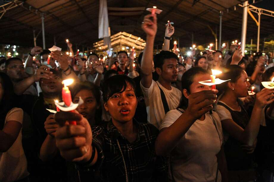 Residents of the city of Medan on Indonesia's Sumatra island hold a candlelight vigil Sunday in honor of the bombing victims. Photo: Ivan Damanik / AFP / Getty Images