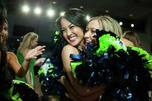 The newly announced members of the 2018 Sea Gals cheerleading squad celebrate after the final day of tryouts, on Sunday, May 13, 2018 at CenturyLink Field in Seattle, Wash. The women were judged on dance ability, physical appearance and showmanship.