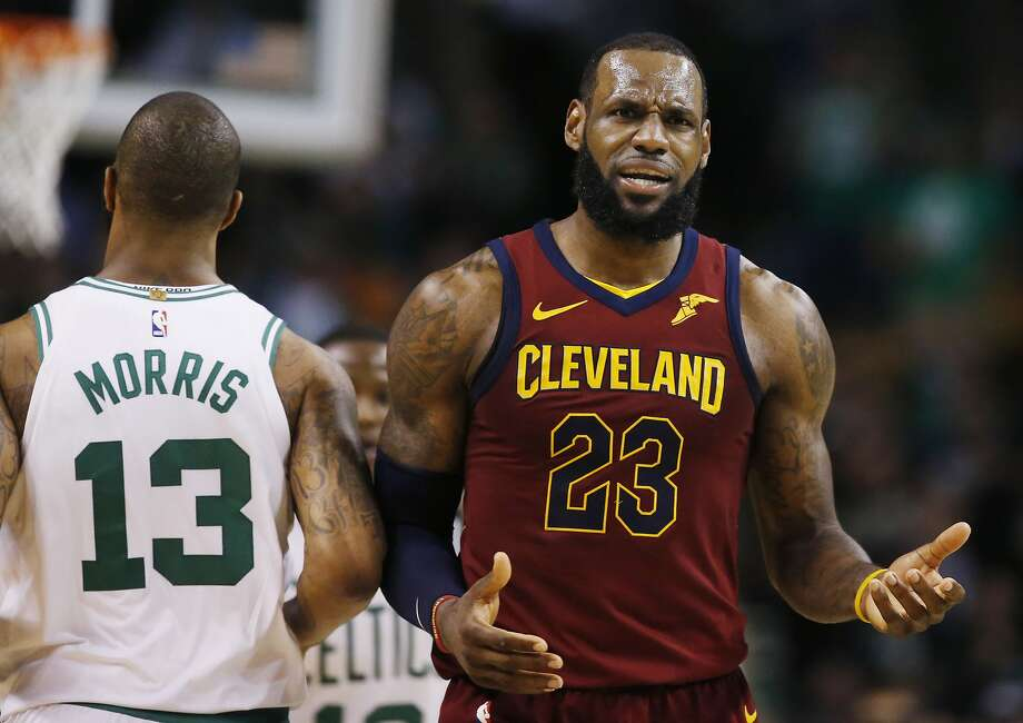 Cleveland Cavaliers forward LeBron James (23) reacts next to Boston Celtics forward Marcus Morris (13) during the third quarter of Game 1 of the NBA basketball Eastern Conference Finals, Sunday, May 13, 2018, in Boston. (AP Photo/Michael Dwyer) Photo: Michael Dwyer, Associated Press