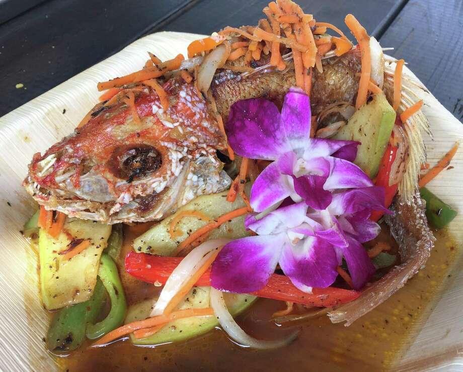 Jamaican escovitch fish from The Jerk Shack. Photo: Paul Stephen / San Antonio Express-News
