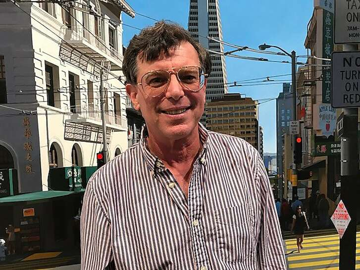 Artist Seth Tane in front of his cityscape painting of San Francisco, at Modernism Gallery